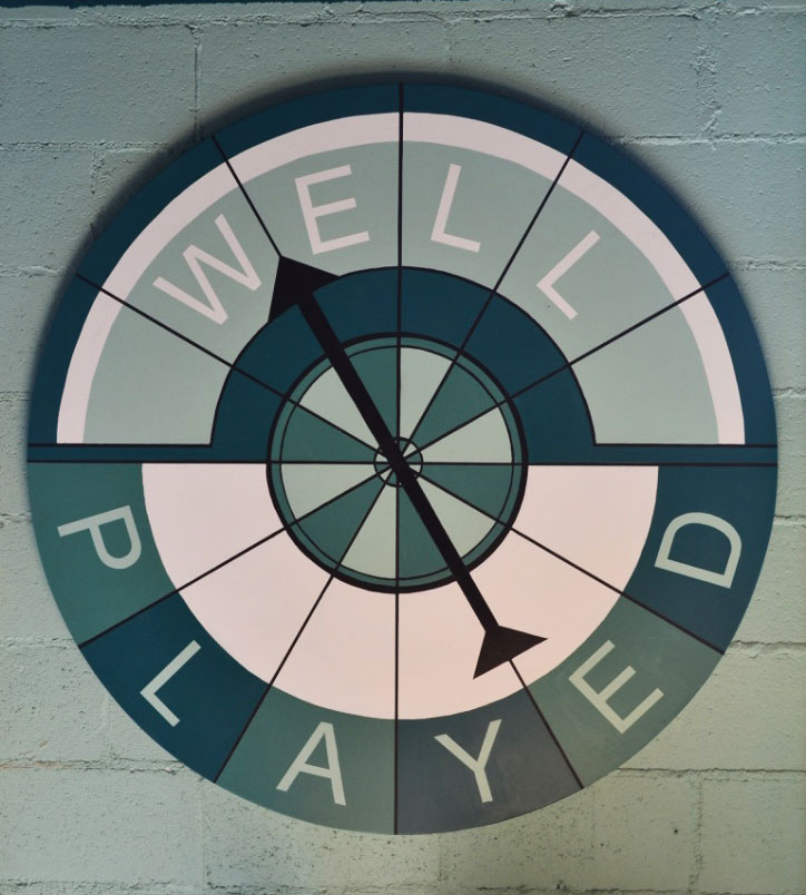 Contact us today! Well Played's fun spinner sign painted by local muralist.