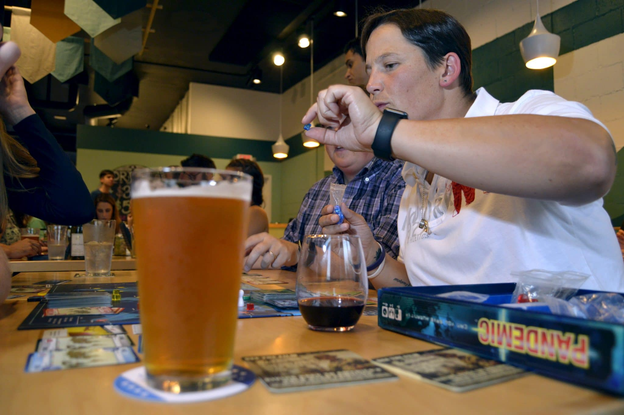 Customers enjoy a wide assortment of craft beers and wine while they play games and have fun